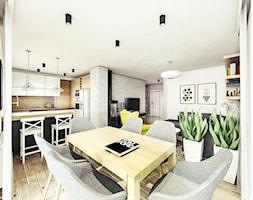 Mieszkanie w stylu skandynawskim pod Rzeszowem. - Średnia otwarta biała jadalnia w salonie, styl skandynawski - zdjęcie od MEEKO Architekci