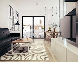 Mieszkanie w stylu loftowym w Krakowie - Mała otwarta biała jadalnia w kuchni, styl industrialny - zdjęcie od MEEKO Architekci