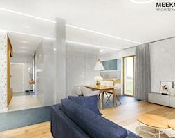 Mieszkanie w stylu nowoczesnym w Rzeszowie. - Średni szary salon z kuchnią z jadalnią, styl nowocze ... - zdjęcie od MEEKO Architekci - Homebook