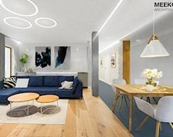 Mieszkanie w stylu nowoczesnym w Rzeszowie. - Średni szary biały salon z jadalnią z tarasem / balkon ... - zdjęcie od MEEKO Architekci - Homebook