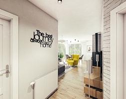 Mieszkanie w stylu skandynawskim pod Rzeszowem. - Mały biały hol / przedpokój, styl skandynawski - zdjęcie od MEEKO Architekci