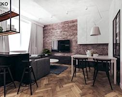 Mieszkanie loft w Mielcu - Średnia otwarta biała jadalnia w kuchni w salonie, styl industrialny - zdjęcie od MEEKO Architekci