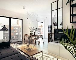 Mieszkanie w stylu loftowym w Krakowie - Średnia otwarta biała jadalnia w kuchni w salonie, styl industrialny - zdjęcie od MEEKO Architekci