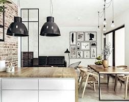 Mieszkanie w stylu loftowym w Krakowie - Średnia biała jadalnia w salonie, styl industrialny - zdjęcie od MEEKO Architekci
