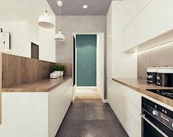 Mieszkanie w stylu skandynawskim w Warszawie - Średnia otwarta szara kuchnia dwurzędowa, styl skandynawski - zdjęcie od MEEKO Architekci