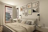 kolorowe grafiki w ramach na ścianie w sypialni, szare łóżko