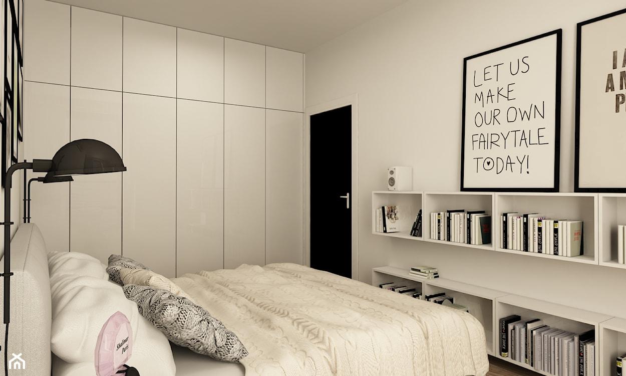 biała sypialnia, biała szafa, czarna lampa metalowa, czarne drzwi, czarno-białe grafiki na ścianie