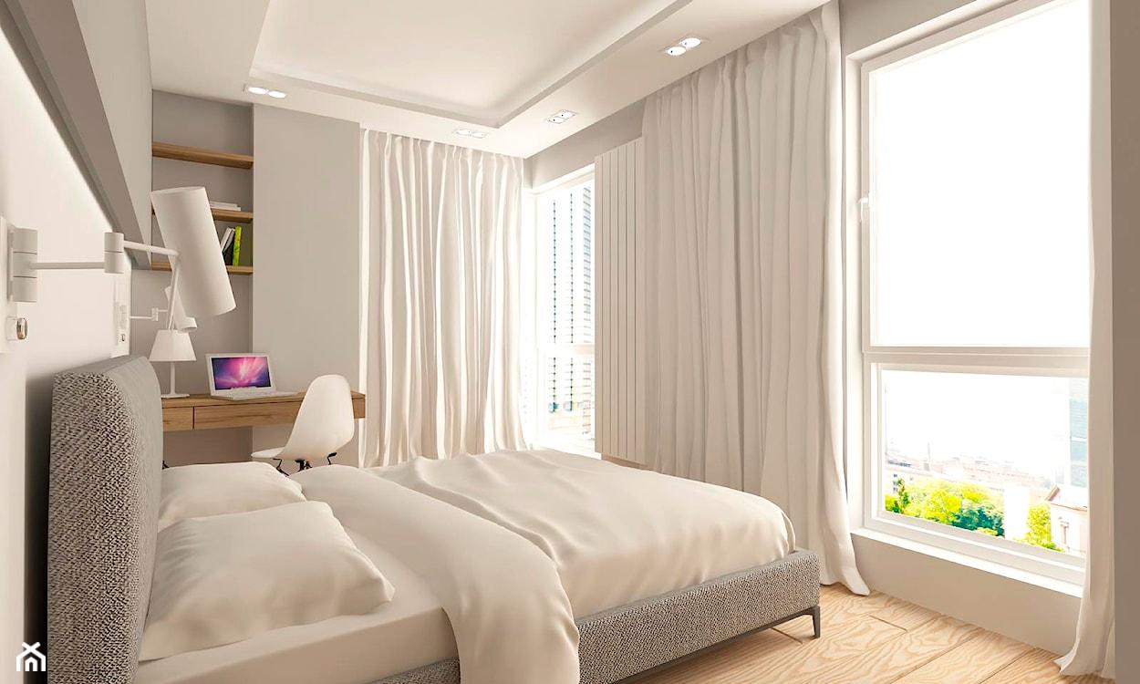 feng shui w sypialni, szare łóżko, biała pościel, biała lampa ścienna