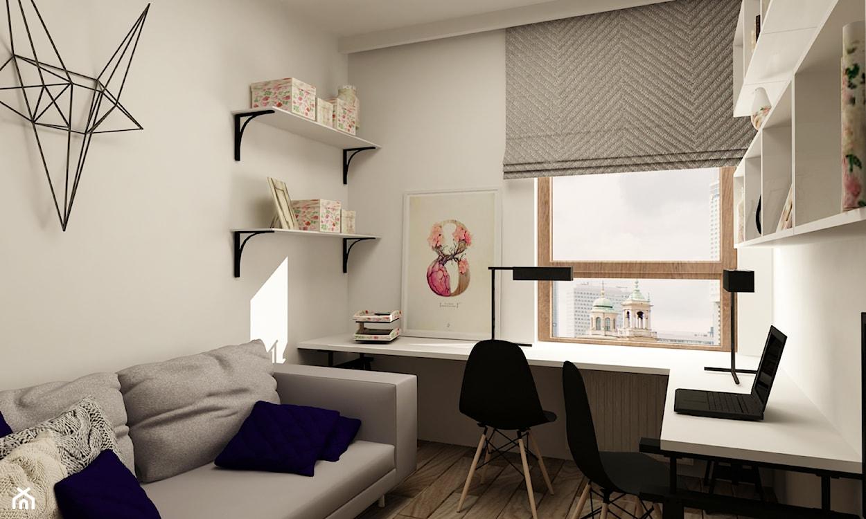 druciana dekoracja ścienna, szara roleta rzymska, szara sofa, granatowa poduszka, białe biurko narożne, czarne krzesło