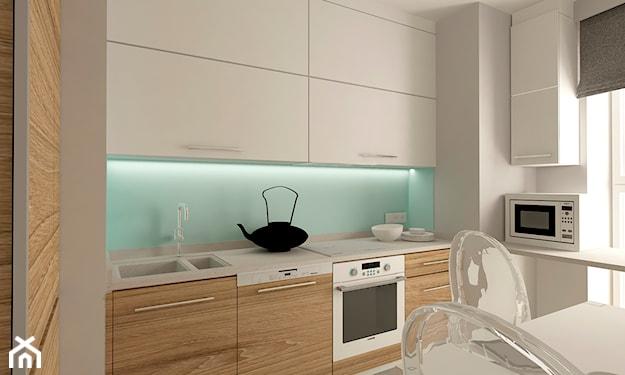 białe szafki kuchenne, biały blat kuchenny, krzesła z bezbarwnego tworzywa, biały stół kuchenny