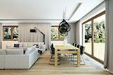 drewniana podłoga, biała sofa, czarna lampa podłogowa, lampa wisząca druciana