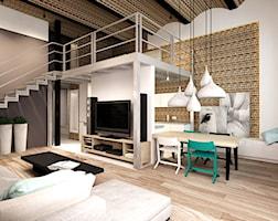 Salon loftu z widokiem na antresolę - zdjęcie od design me too