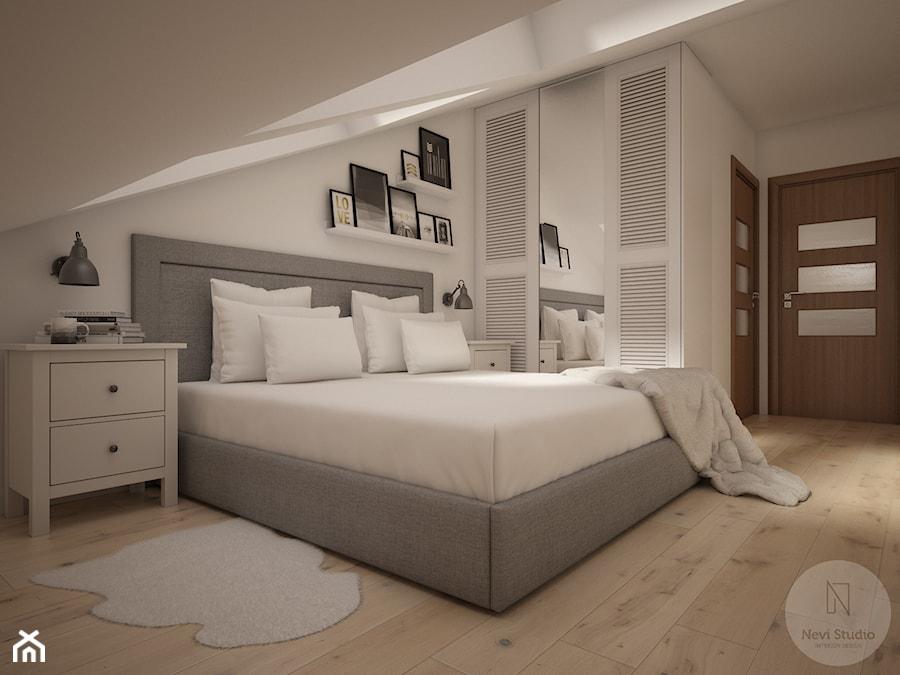 Widok na łóżko oraz szafę - zdjęcie od Nevi Studio