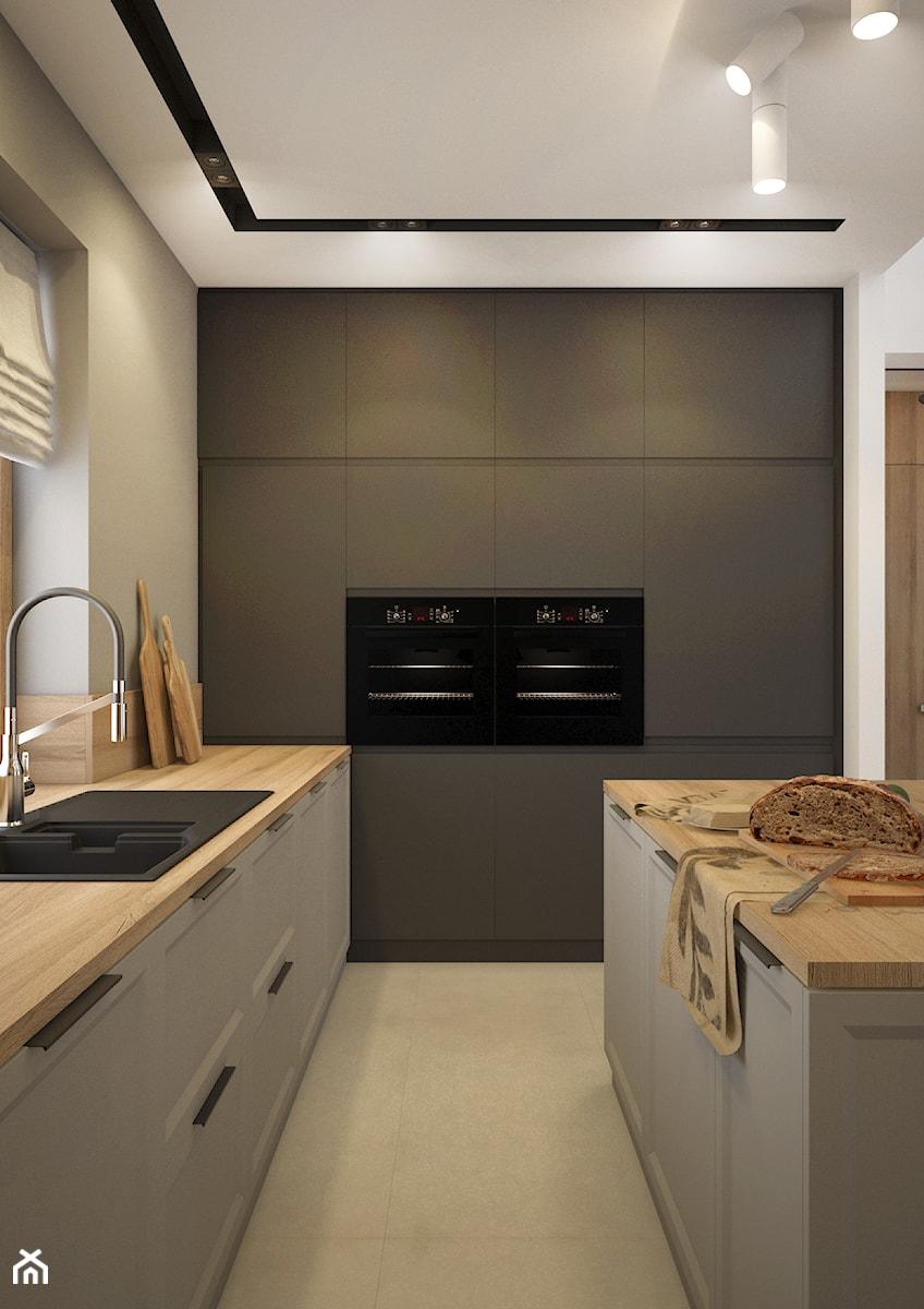 Kuchnia - wysoka zabudowa - zdjęcie od Nevi Studio
