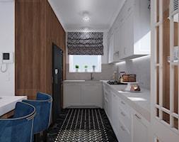 Warszawskie Art Deco - Duża otwarta szara kuchnia w kształcie litery u z oknem, styl art deco - zdjęcie od 4 kąty a stół 5
