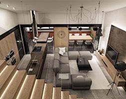 Wnętrze eleganckiego loftu - Duży biały brązowy salon z kuchnią z jadalnią, styl industrialny - zdjęcie od KJ Architekci