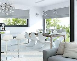 Projekt domu HomeKONCEPT 32 - Średnia otwarta biała jadalnia w kuchni w salonie, styl nowoczesny - zdjęcie od HomeKONCEPT Projekty Domów Nowoczesnych