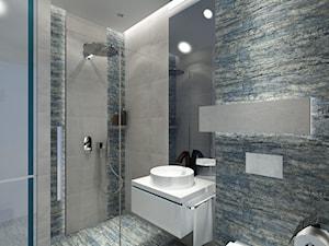 Łazienka z niebieską płytką