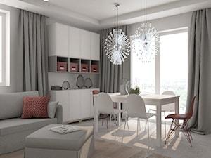Mieszkanie w odcieniach szarości bieli i czerwieni