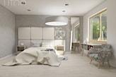 podłoga z jasnego drewna, biała lampa wisząca, szary fotel w kwiaty
