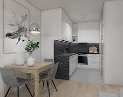SYPIALNIA W SALONIE - Średnia otwarta biała kuchnia w kształcie litery u, styl nowoczesny - zdjęcie od UTOO- pracownia architektury wnętrz i krajobrazu
