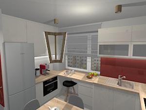 Kuchnia z elementami czerwieni i drewnem dębowym - zdjęcie od lightcenter.pl