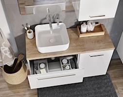 Umywalki nablatowe - Biała łazienka w bloku w domu jednorodzinnym bez okna - zdjęcie od Elita - Homebook