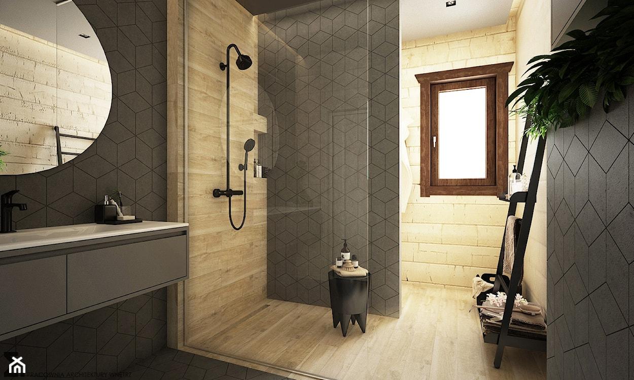 płytki gresowe z motywem drzewa w łazience, czarna bateria prysznicowa, rośliny w łazience