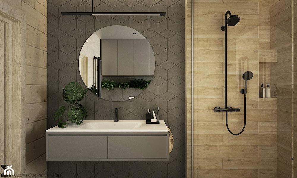okrągłe lustro łazienkowe, szare płytki, czarna bateria umywalkowa
