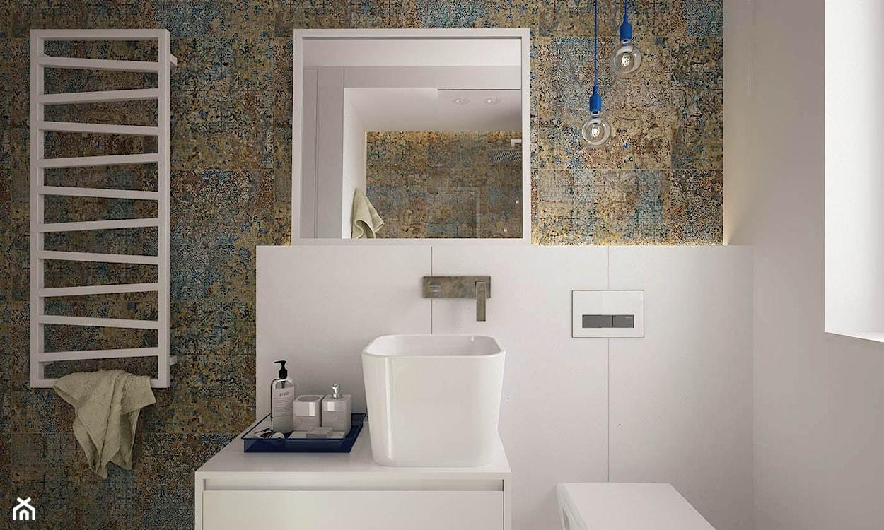 płytki przypominające stare malowidło ścienne, wysoka misa umywalki