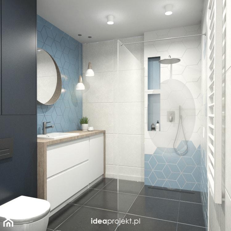 Nadmorski klimat II - Mała czarna niebieska łazienka w bloku w domu jednorodzinnym bez okna, styl skandynawski - zdjęcie od idea projekt