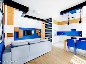 mieszkanie 60m2 ul.Kryształowa Lublin - Duża otwarta biała niebieska jadalnia w kuchni w salonie, styl minimalistyczny - zdjęcie od Auraprojekt