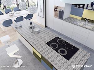 Blaty kuchenne - Duża otwarta biała kolorowa kuchnia dwurzędowa w aneksie z wyspą, styl nowoczesny - zdjęcie od SWISS KRONO
