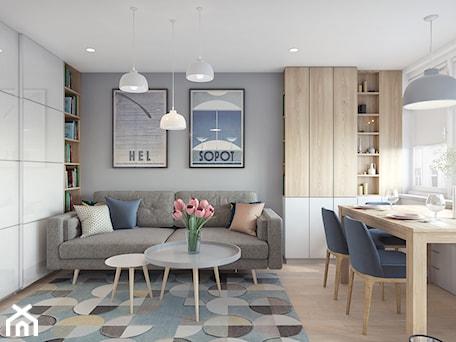 Remont mieszkania 50m2 - Mały szary biały salon z bibiloteczką z jadalnią, styl nowoczesny - zdjęcie od Przestrzenie