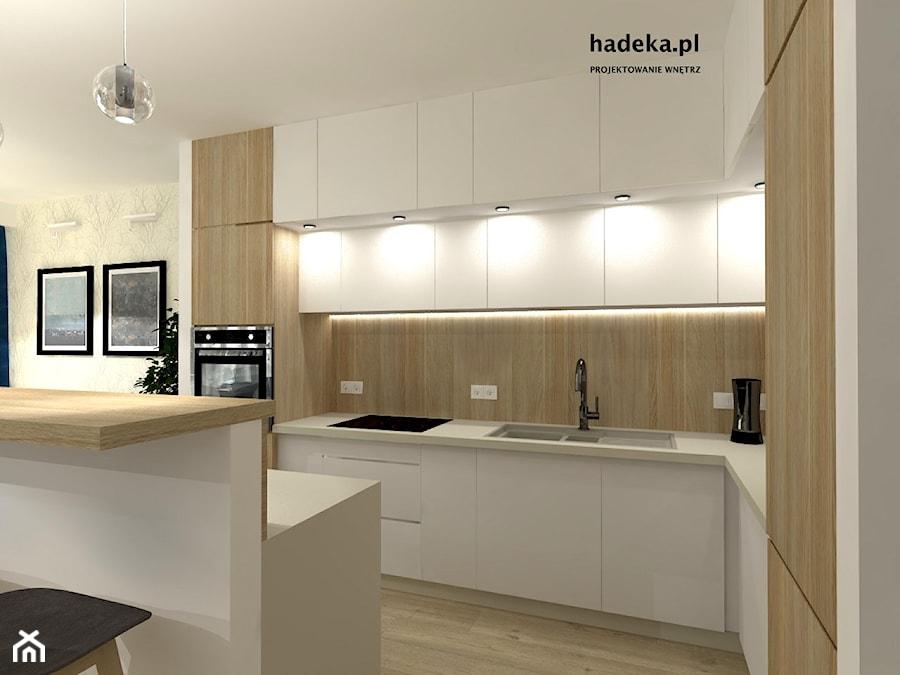 KUCHNIA Z SALONEM - Średnia otwarta beżowa kuchnia w kształcie litery l z wyspą, styl nowoczesny - zdjęcie od HaDeKa Biuro Projektowe