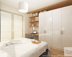 Projekt mieszkania w Wilanowie, pow. 52 m2 - Średnia biała sypialnia dla gości, styl nowoczesny - zdjęcie od 4ma projekt - Homebook