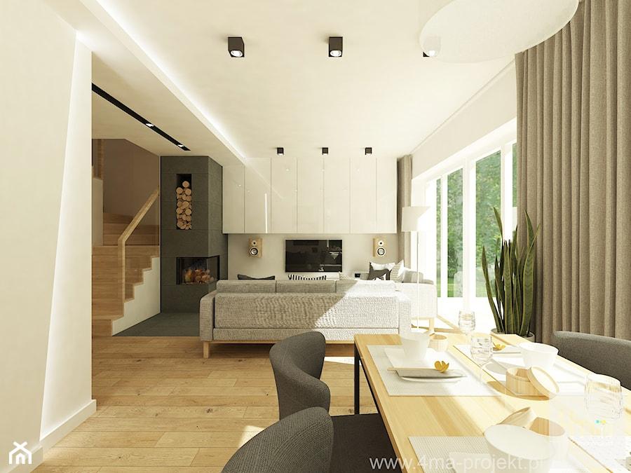 Projekt domu o pow. 125 m2 w Ożarowie Mazowieckim - Duży biały beżowy salon z jadalnią, styl nowoczesny - zdjęcie od 4ma projekt