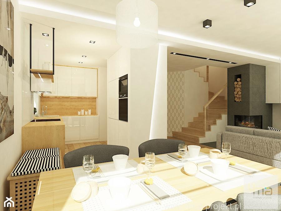 Projekt domu o pow. 125 m2 w Ożarowie Mazowieckim - Duży szary biały beżowy salon z kuchnią z jadalnią, styl nowoczesny - zdjęcie od 4ma projekt