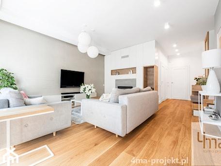 Aranżacje wnętrz - Salon: Dom 148 m2. - Średni szary biały salon, styl nowoczesny - 4ma projekt. Przeglądaj, dodawaj i zapisuj najlepsze zdjęcia, pomysły i inspiracje designerskie. W bazie mamy już prawie milion fotografii!