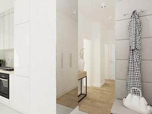 Projekt mieszkania na Bielanach o pow. 51,5 m2. - Mały biały hol / przedpokój, styl nowoczesny - zdjęcie od 4ma projekt