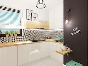 Projekt mieszkania w Wilanowie, pow. 52 m2 - Duża otwarta biała czarna kuchnia w kształcie litery l, styl skandynawski - zdjęcie od 4ma projekt