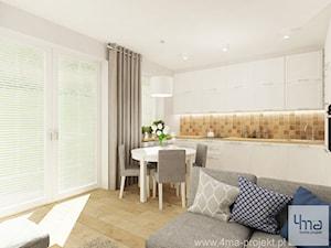 Projekt salonu z aneksem kuchennym 22 m2 i łazienki 5,2 m2. - Duża otwarta kuchnia w kształcie litery u w aneksie, styl skandynawski - zdjęcie od 4ma projekt