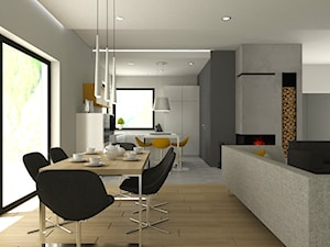 Salon z kuchnią z żółtymi dodatkami.