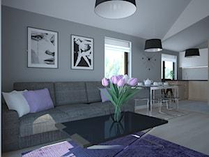 Salon z fioletowymi dodatkami