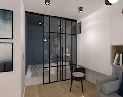 Metamorfoza Mieszkania 33 m2 - Mała biała czarna sypialnia małżeńska, styl skandynawski - zdjęcie od CKkwadrat