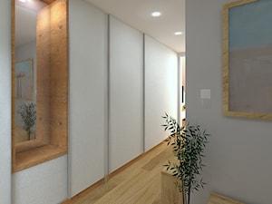 Dwupoziomowy apartament w Gdyni - Średnia otwarta garderoba, styl minimalistyczny - zdjęcie od CHATANOWA