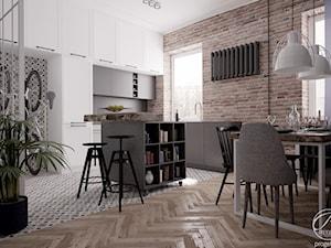 Mieszkanie w klimatycznej kamienicy - Średnia otwarta brązowa jadalnia w kuchni w salonie, styl industrialny - zdjęcie od Progetti Architektura
