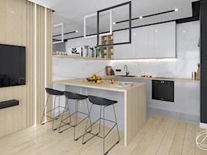 Apartament Bluszczańska - Średnia biała beżowa czarna kuchnia w kształcie litery g w aneksie z wyspą, styl nowoczesny - zdjęcie od Progetti Architektura