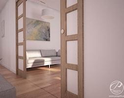 Apartamenty Marymont - Małe białe biuro domowe w pokoju, styl nowoczesny - zdjęcie od Progetti Architektura