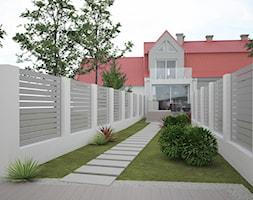 Przebudowa domu z aranżacją wnętrz - Średni ogród za domem w stylu skandynawskim - zdjęcie od ROARHIDE Industrial Designs